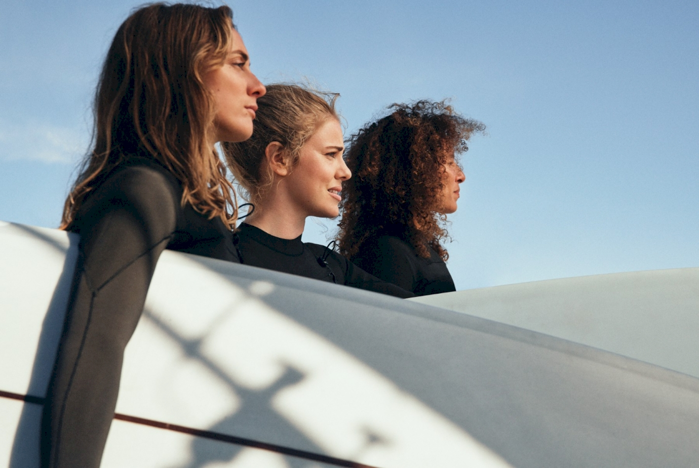 H&M collaborates with all-female surf collective Women + Waves for a sustainable swimwear collection.